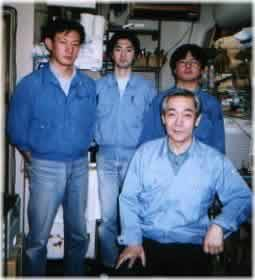[Kondo-San at the front; on the back are messrs Ashizawa (Manager, Acoustic Development), Oda (makes capacitors and resistors), Yoshida (amplifier wiring) from left to right]