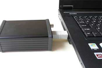 [John Kenny SPDIF Mk 3 USB converter - coupled to laptop computer with rigid adaptor.]