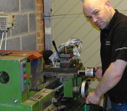 [Michael at lathe]
